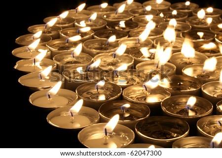 many small candlestick encrusted dark shape background