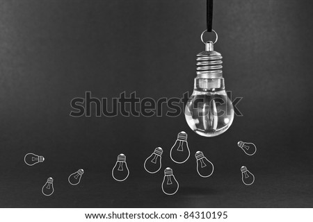 Many small ideas concept with light bulb