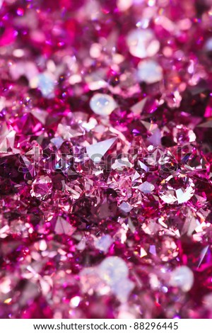Many small ruby diamond stones, luxury background shallow depth of field