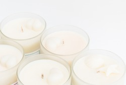 Many soy wax candles together on the white background