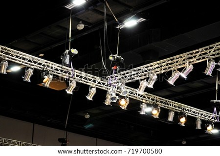 many spotlights that illuminate the stage at a concert #719700580