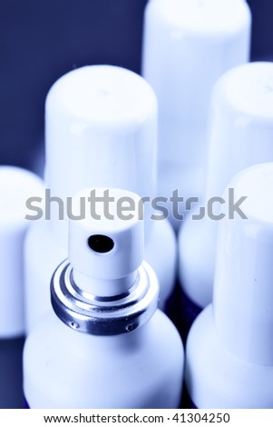 Many spray cans with drugs close up