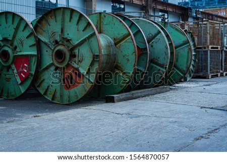 Many steel cable reels, industrial area with steel cable reels, old cable reels  #1564870057