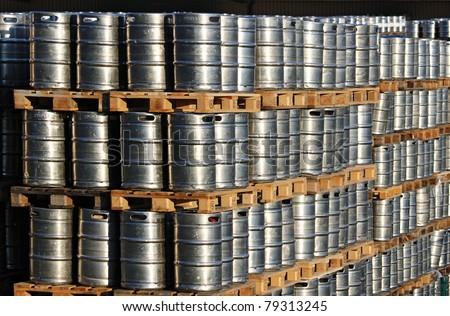 many steel kegs of beer in warehouse