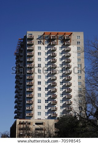 Many-storied apartment (condo) building on blue sky background