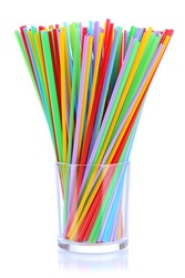 Many straws in glass isolated on white