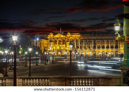 Many street lamps illuminate the Place de la Concorde at night in Paris. #156112871