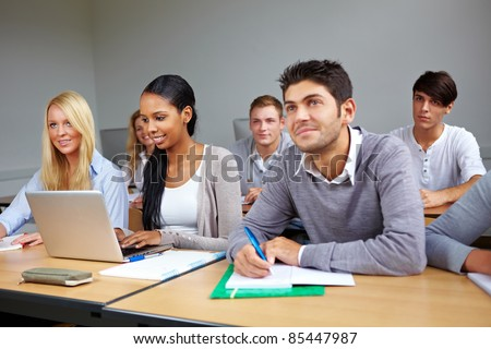 Many students listening in a university class