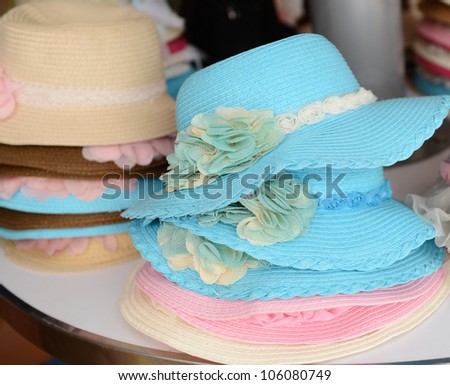 many summer hats in a shop.