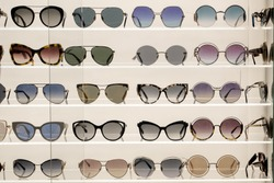 Many sunglasses on display in shop. Fashion Sunglasses in shop.