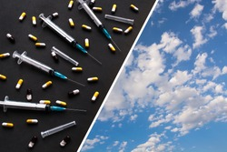 Many syringes and scattered pills on black  diagonally divided background against blue sky with white clouds. Drugs danger to life concept. Drugs addict freedom concept