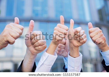 Many thumbs of different business people pointing up Stock photo ©