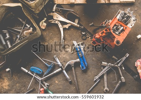 Many Tools on dirty floor, Set Craftsman tool , mechanical tools. Professional  mechanic using different tools for working in auto repair service.