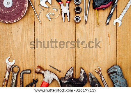 Many tools on wooden background #326199119