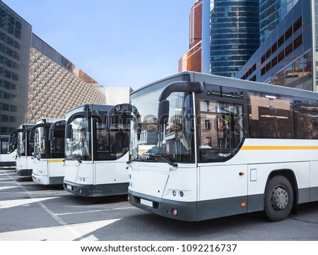 many tourist buses at the bus station in the city