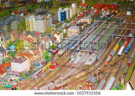 Many trains on large miniature railway train station model. Handmade railways model. #1037915506