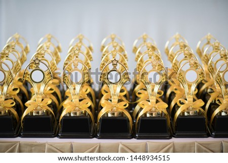 Many trophies on table, Golden Trophy. #1448934515
