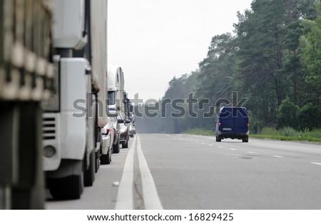 Many trucks stopped on European road