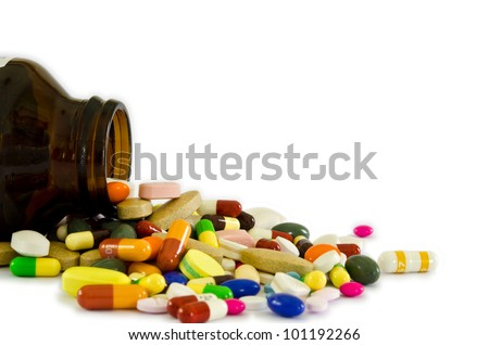 Many type of drugs poring from the bottle woth isolation background.