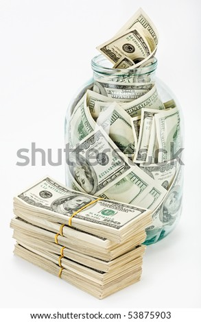 Many 100 US dollars bank notes in a glass jar and bundle isolated  on white background