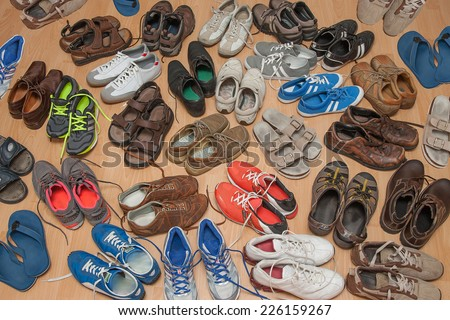 many used men shoes on the floor