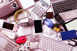 Many used modern Electronic gadgets for daily use on White floor, Reuse and Recycle concept, Top view.