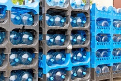 Many water container in a rack