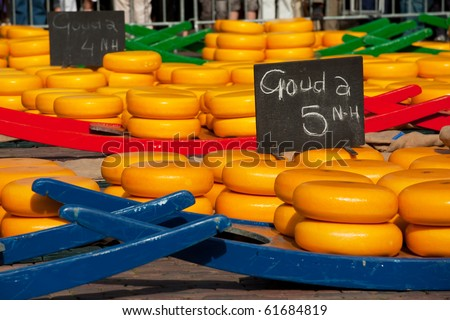 Many whole Dutch cheese at the market in Alkmaar - stock photo