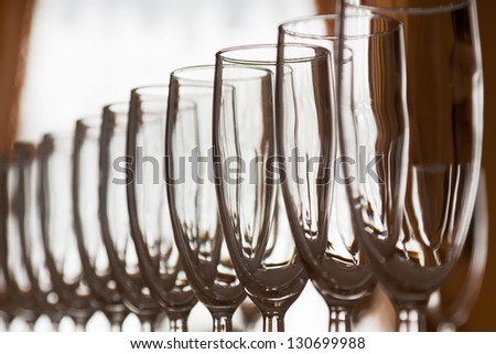Many wineglasss in rows in bar - stock photo
