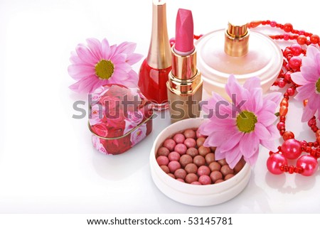 Many   woman cosmetics with flower   on white white background