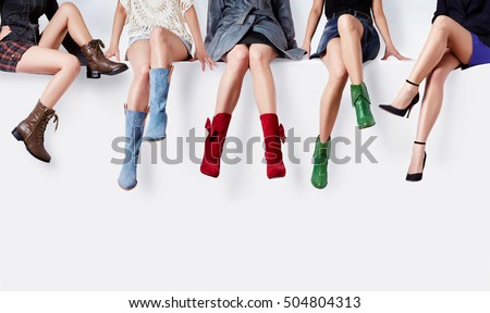 Many woman with colorful shoes sitting together. Fashion image with copy space.  #504804313
