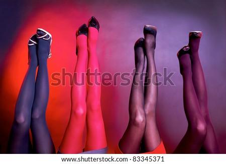 Many women's stockinged legs raise up
