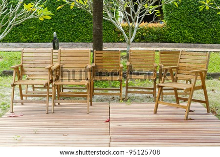many wooden chairs in the garden