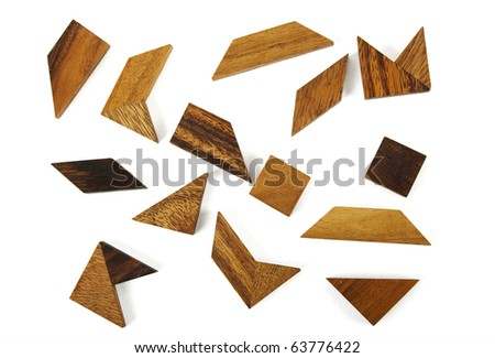 many wooden geometrical figures puzzle isolated