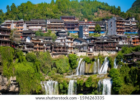 Many wooden house and water falls  in Furong town, Furong town  is an ancient town with a history of two thousand years. It is located in yongshun county, xiangxi autonomous prefecture, Hunan, China