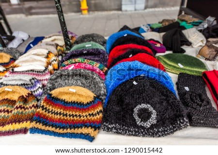 a57c6a7180b Many wool handmade hats on display in street outdoor market with colorful  pattern design in Iceland