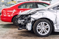 Many wrecked car after traffic accident crash at restore service maintenance station garage indoor. Insurance salvage vehicle auction wholesale storage. Auto body wreck damage work workshop center