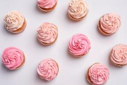 Many yummy cupcakes on white background