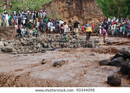 MANYARA, TANZANIA - NOVEMBER 28: The catastrophic debris flow destroyed a road between national parks Manyara and Ngorongoro. Car traffic was restored on the same day, on November 28, 2011 in Tanzania