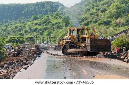 MANYARA, TANZANIA - NOVEMBER 28: The catastrophic mudflow flow destroyed a road between national parks Manyara and Ngorongoro. Car traffic was restored on the same day, November 28, 2011 in Tanzania