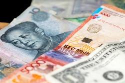 mao and Washington and Kazakh money