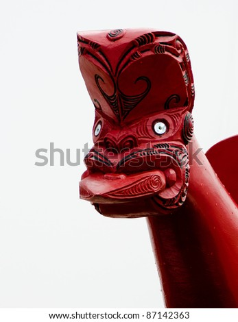 Maori boat figurehead with tongue protruding