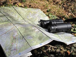 map and binoculars outdoor