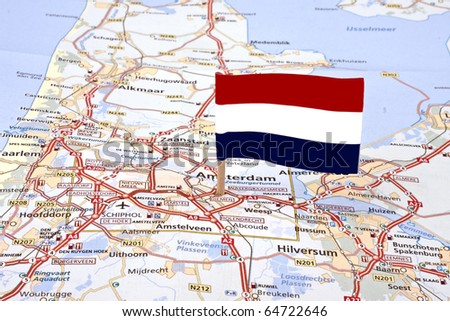 Map from the Netherlands with the dutch flag pointed at the capital Amsterdam