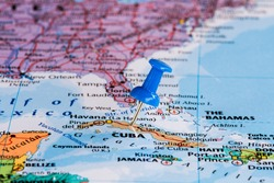 Map of Cuba with a blue pushpin stuck