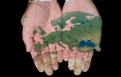 Map Of Europe Painted On Hands Showing Concept Of Europe In Our Hands