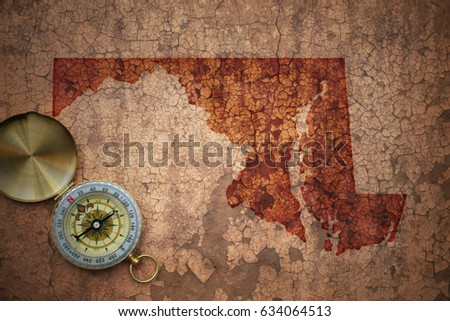 map of maryland state on a old vintage crack paper background with compass