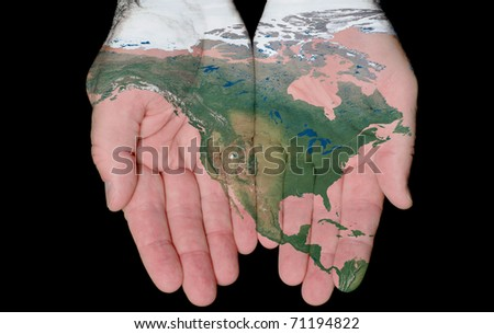 Map Of North America Painted On Hands Showing Concept Of North America In Our Hands