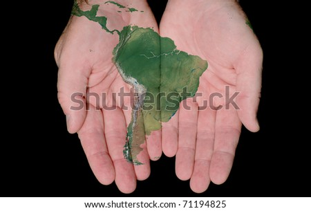 Map Of South America Painted On Hands Showing Concept Of South America In Our Hands