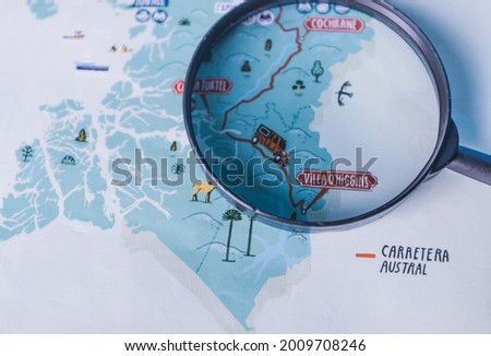 Map of the chilean Patagonia and a magnifying glass over it. Carretera Austral. Horizontal image Foto stock ©